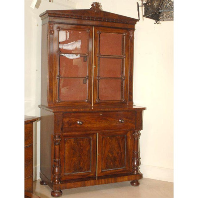 A beautiful William IV Period mahogany secretary bookcase made in England circa 1835. A drop down writing platform and...