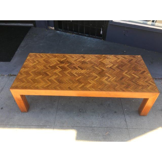 Amazing custom coffee table with incraticate herringbone wood top. Wonderfully designed and proportioned - excellent...