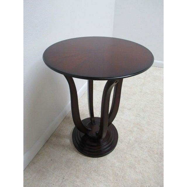"A Bombay Company cherry side table. Measurements ( L x W x H) 20 x 20 x 26.25"" . Nice shape... minor wear. Please see..."