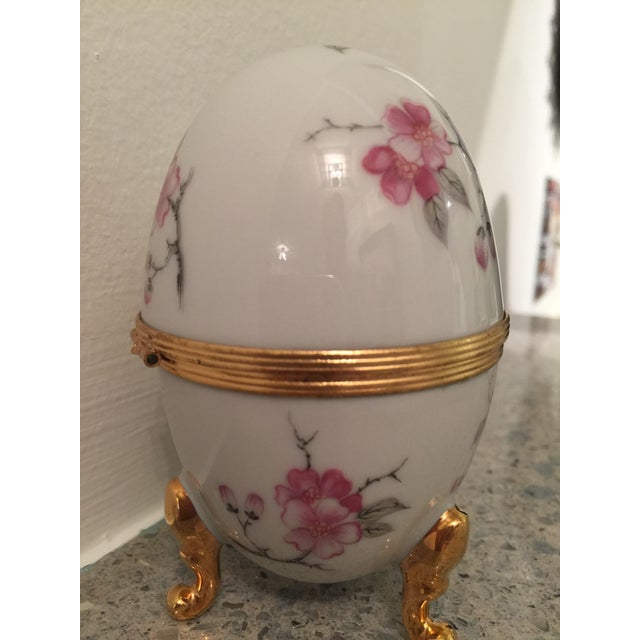 Vintage porcelain Limoges 3 golden footed trinket box, hinged box with flower motif clasp. Beautiful cherry blossoms...