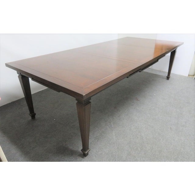 Large 9 foot Italian style farm table with walnut, tapered legs and step notched skirt. Solid top. Does not extend to take...
