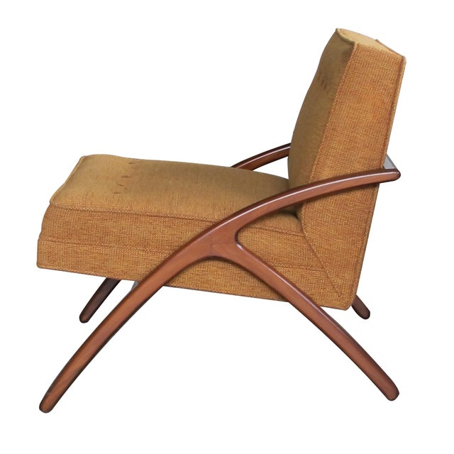With elegant lines, each chair with upholstered back and seat resting on a graceful wooden frame with arching legs joined...