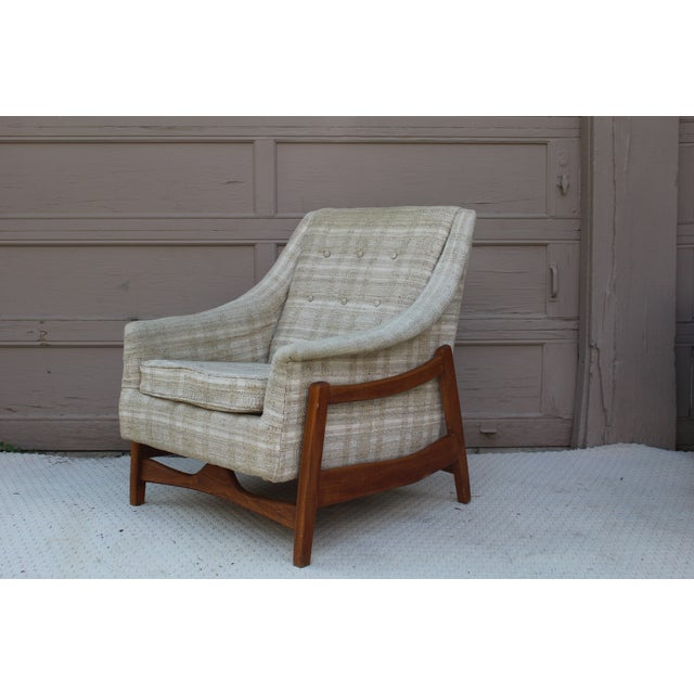 Paoli rocker lounge chair with walnut frame produced in Indiana, circa 1963, very similar to Danish style. The fabric is a...