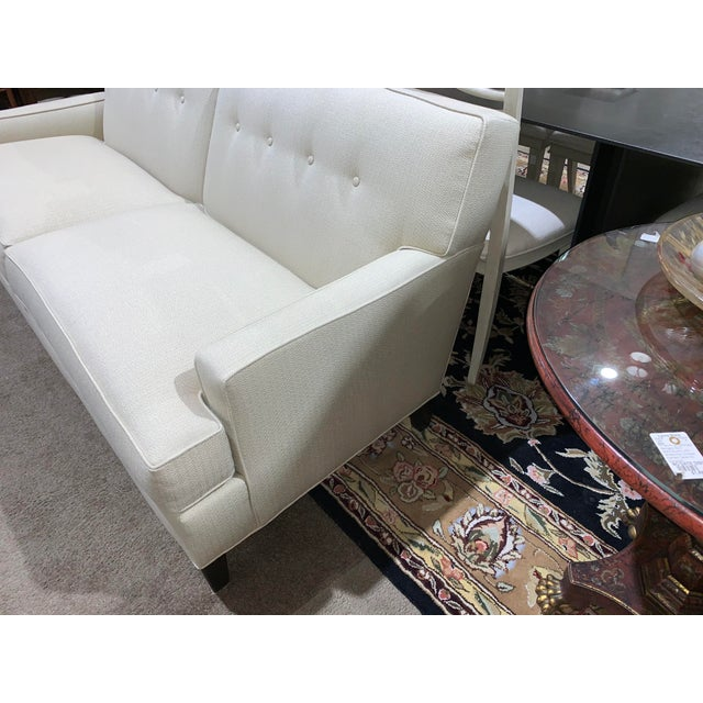 Ethan Allen tuxedo sofa with a mid century design, button accents on the cushion backs, and what Ethan Allen would...