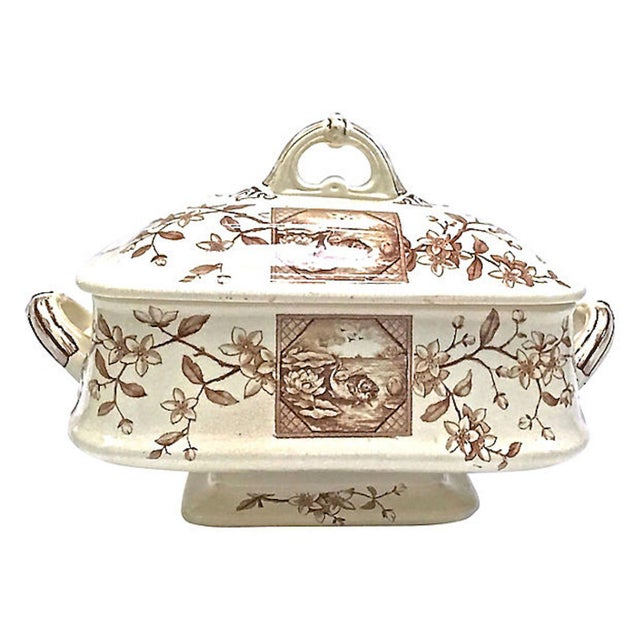 Antique aesthetic movement scenic transferware tureen with handled lid and side handles. Lid and sides have small scenic...