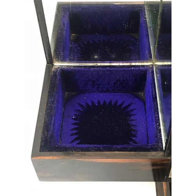 Gorgeous locking decanter tantalus box. Coromandel wood box. Victorian period, circa 1870s Interior opens to mirrored back...