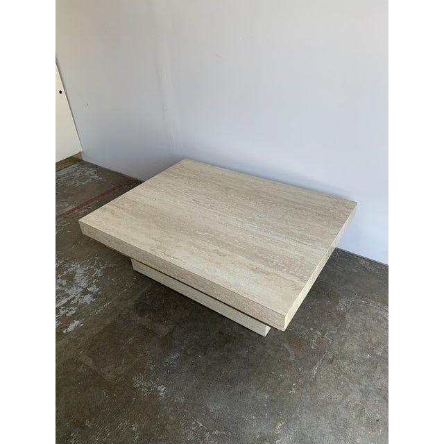Late 1980s coffee table in faux laminate travertine and brass lining. This item is well preserved with no large scratches,...