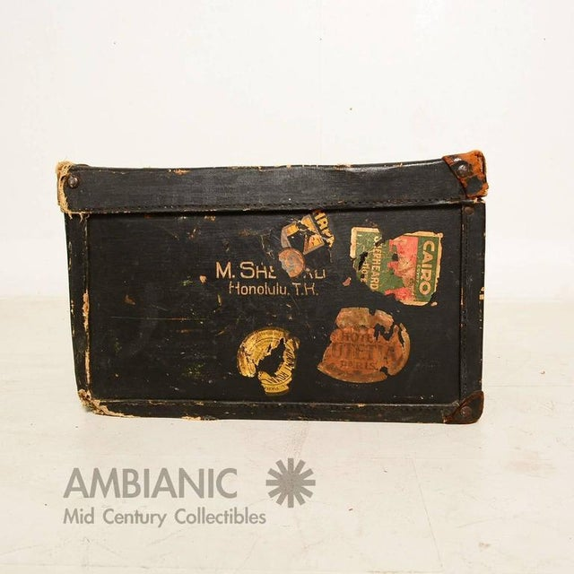 For your consideration a distressed travel case in black canvas and leather accent/ handles. It has some serial numbers on...
