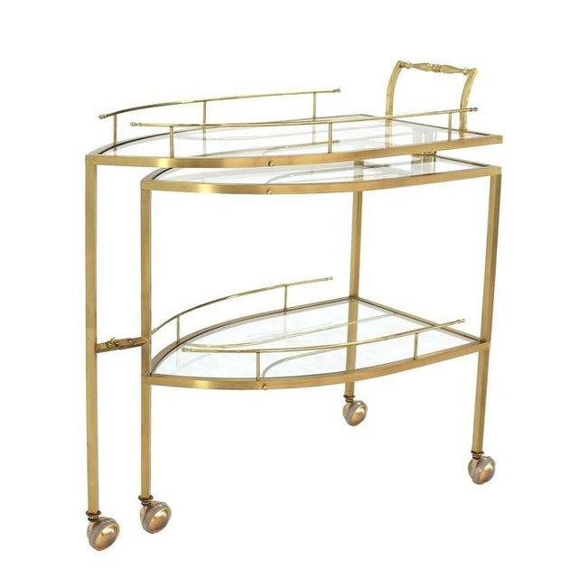 Very nice unusual iron shape brass teacart server or side table.