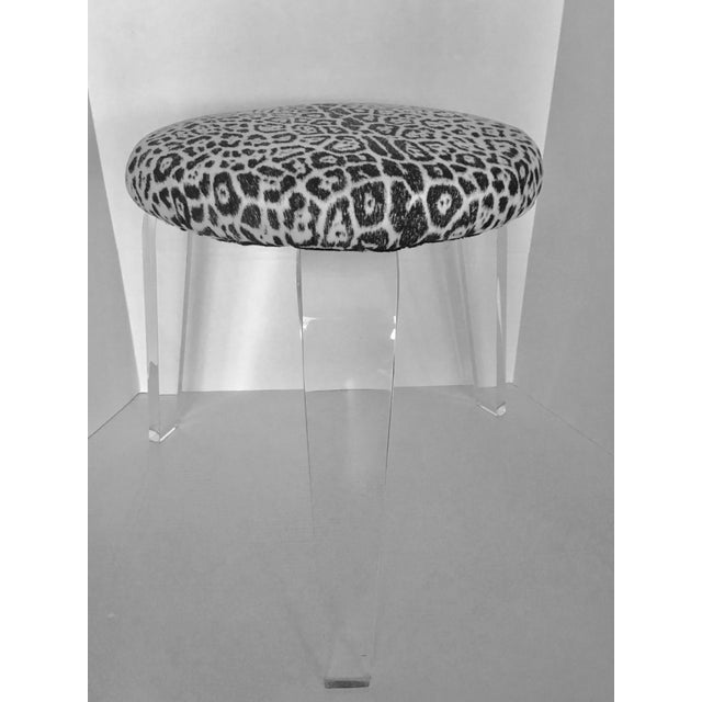 This is a great mid-century stool with three Lucite legs. It is covered in a cotton fabric with a leopard skin design. The...