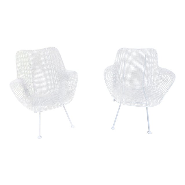 """This stylish pair of Woodard patio chairs are from the """"Sculptura"""" collection and dates to the 1950s-1960s. Note:..."""