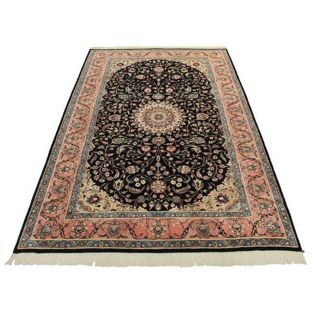 This is a fine hand knotted wool Pakistani or Persian style rug with a medallion design.