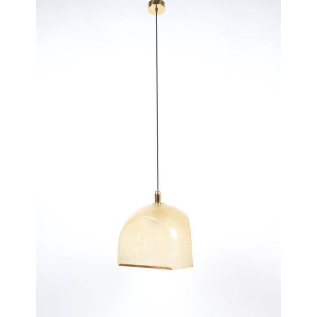 Superb pair of Italian pendant lamps by Salvatore Gregorietti, Italy, 1960 comprised of semi transparent yellowish...