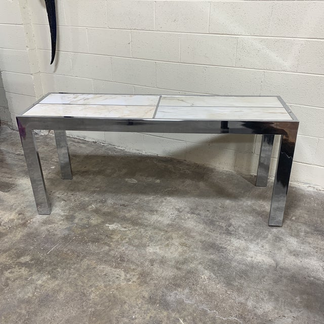 Great mid century chrome and marble console table by Pace. Carrara marble inserts in chrome frame. It's solid and...