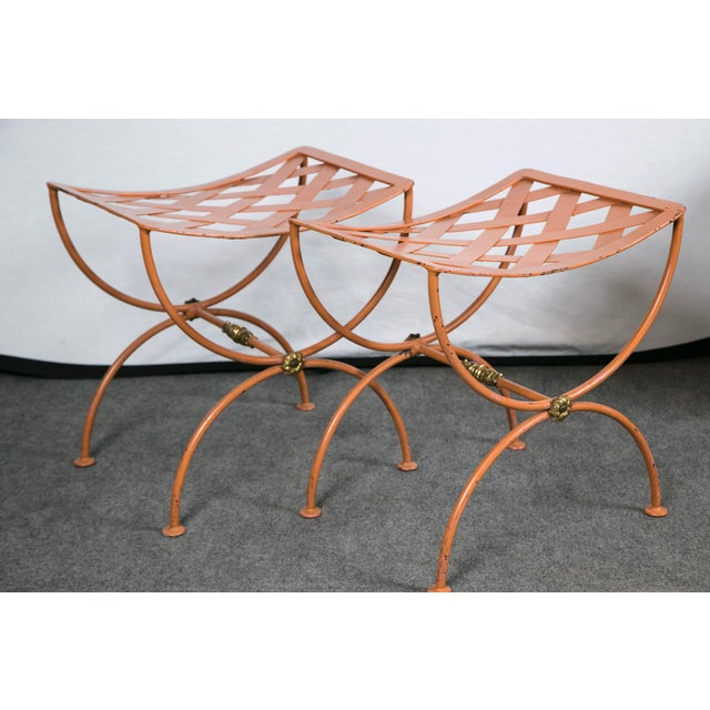 Pair of tole benches with velvet cushions by Jean Charles Moreux.