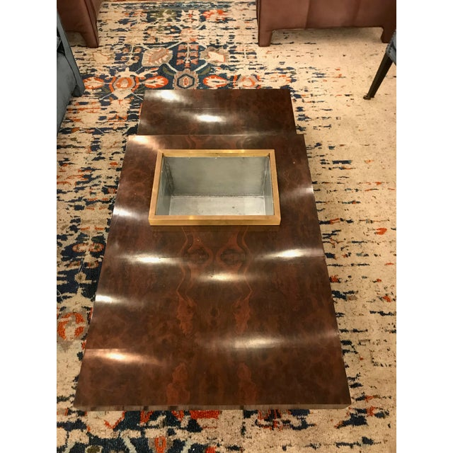 Beautiful Italian, Mid-Century burl wood coffee table with a planter. Makes for a sleek and contemporary feel.