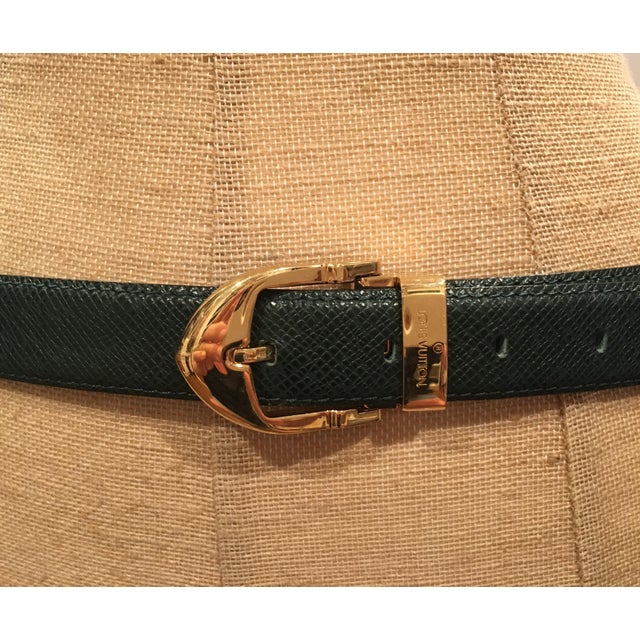 Beautiful hunter green Louis Vuitton ladies belt. Gold hardware. Size 85/34. Made in France. All hardware and leather...