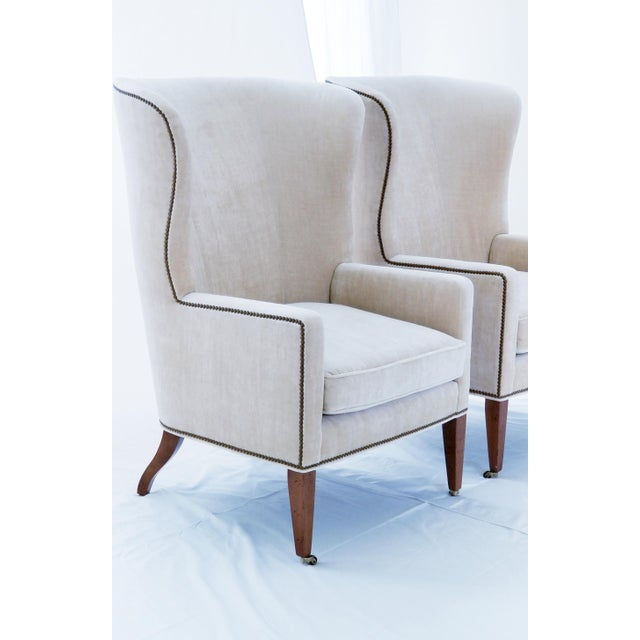 Brand New with Tags, Baker's stunning sculpted modern wing backs. The modest width of these chairs allow them to float in...