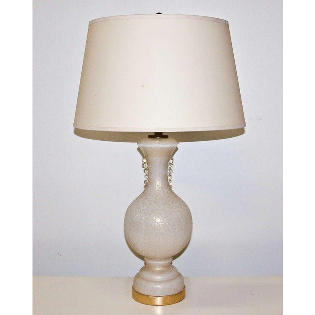 Italy Circa 1940. A very sophisticated Murano white glass lamp with decorative gold inclusions in the manner of Tommaso...
