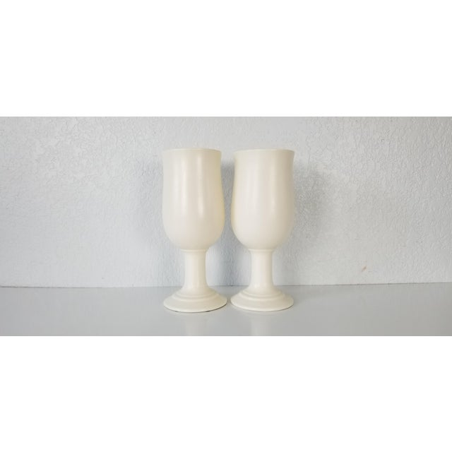 This is a pair of vintage cup shaped vases in the Hollywood Regency style by Royal Haeger. made of Flat white matte...