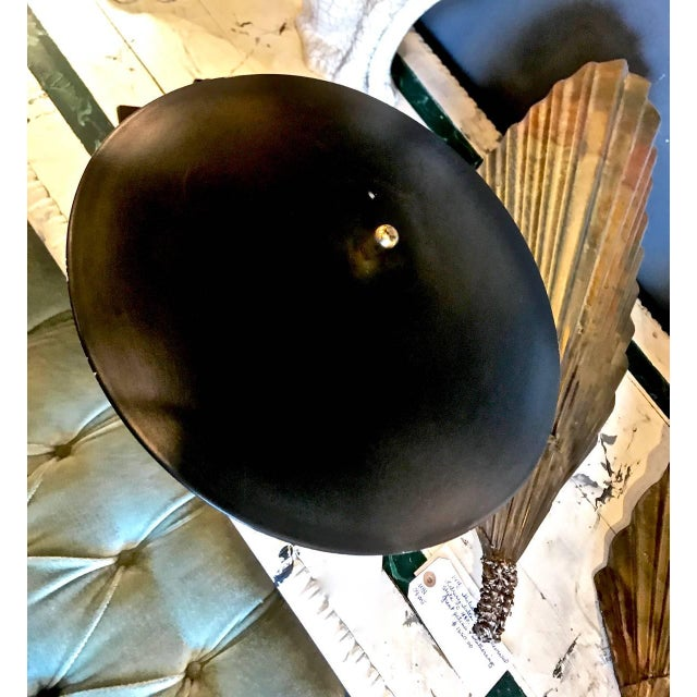 This is a good example of the Dazor, circa 1960 flying saucer desk lamp. This lamp features a polished brass pivoting...