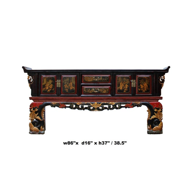 This is a sideboard console table / cabinet / TV stand in oriental Fujian style which has a carving and golden color...