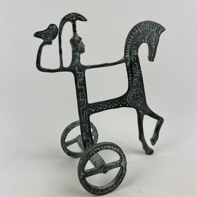 Vintage brass sculpture of a horse and chariot rider holding up an owl. Styled after Frederick Weinberg. A beautiful...
