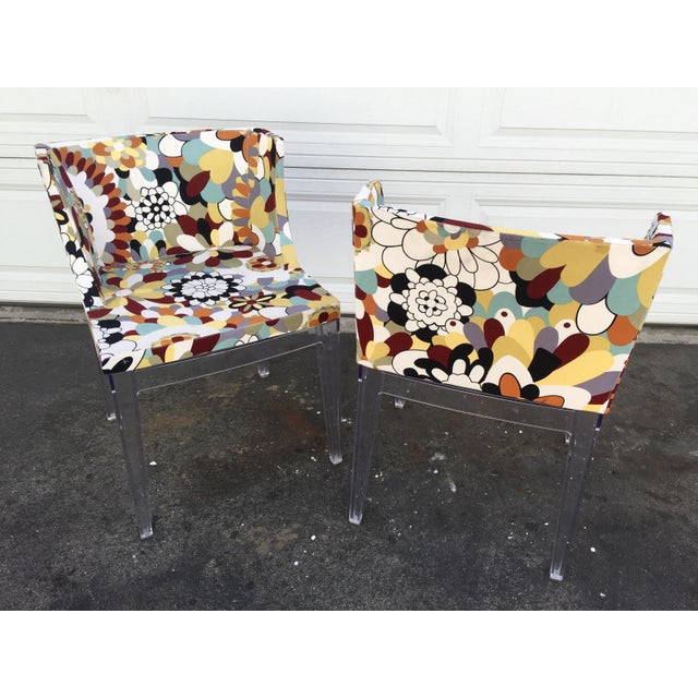 A pair of this floral chairs with acrylic legs. Very stylish and comfortable at the same time. We paid $300 for each....