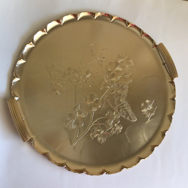 Elegant rose gold toned serving tray or platter with textured butterfly and floral or cherry blossom tree patterned...