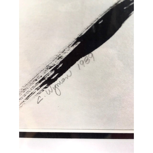 This 1980's black and white minimalist figure of a woman is pencil signed C. Wyman. It is triple matted and framed in faux...