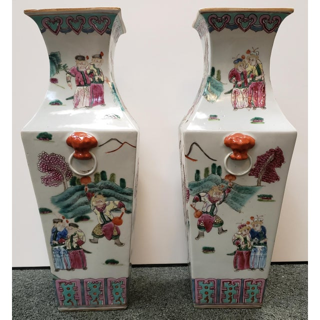Up for sale is a Pair of Circa 1910 Chinese Famille Rose Export Porcelain Warrior Motifs Club-Form Vases (Early Republic)...