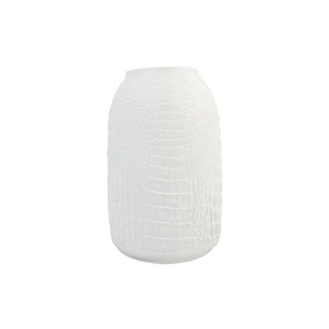 White Modernist bisque porcelain vase featuring a unique crocodile bas relief texture. In excellent condition.