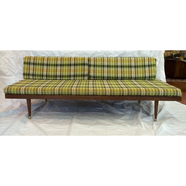 A mid-century modern daybed sofa made by Sears Roebuck. Bottom of wood frame reads that it was made in 1962. Tag on...