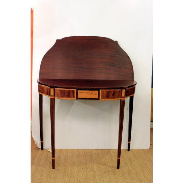Handsome inlaid mahogany flip topgame table with satinwood. The bowed front with curved sides all inlaid with elegant...