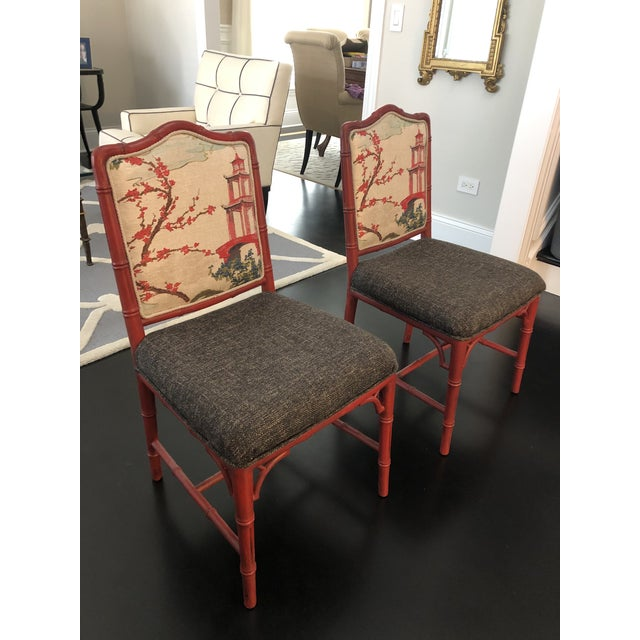 Offered is a pair of chinoiserie style chairs in a deep rise/red chalk paint on faux bamboo frame. Designer upholstery...