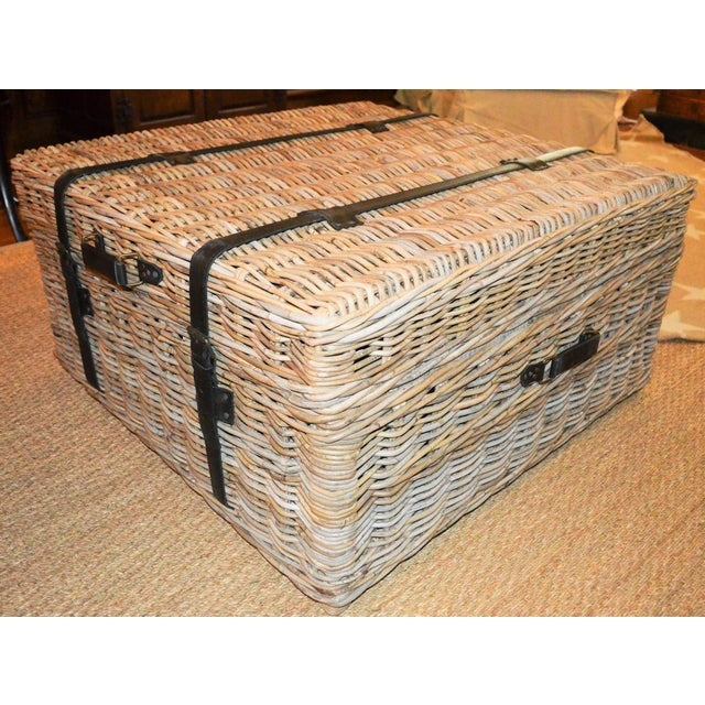 This is an amazing woven rattan coffee table / trunk. This trunk creates a striking focal point to any living room area...