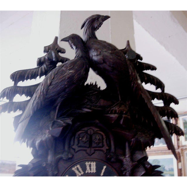 Exceptional 19th century black forest cuckoo clock. Very fine and detailed carving depicting wildlife. Movement is marked...