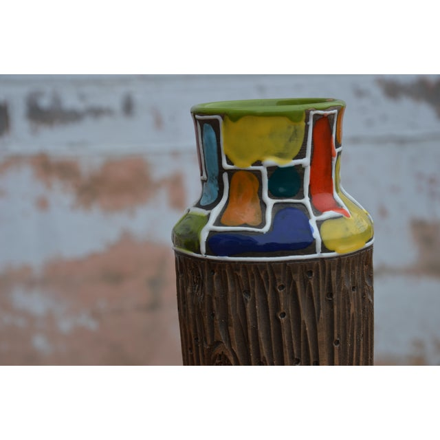 "A Mid-Century modern vase from Raymore by Bitossi with a ""Piet Mondian"" inspired pattern over a carved faux wood motif...."
