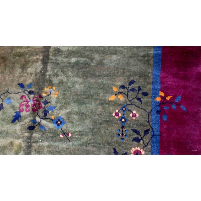 This is antique Art Deco Chinese wool rug in original condition. The rug has a green background color and border in...