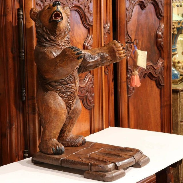 This exquisite antique gun rack was carved in France, circa 1920. The oak sculpture features a young standing bear with...