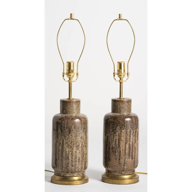 Pair of glazed table lamps in mottled brown and beige tones. Brass hardware with single socket. New wiring, medium base/up...