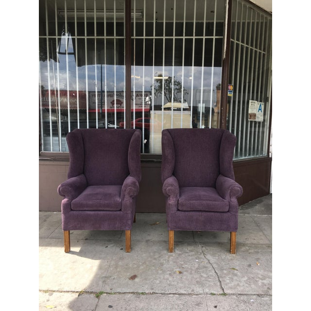 Pair of wing back chairs with purple upholstery, very comfortable to sit on. Has a nice style to them.