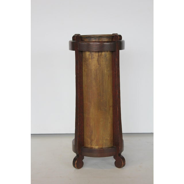 Mission oak and brass umbrella stand by The Lakeside Craft Shops. It has stamp on the bottom.