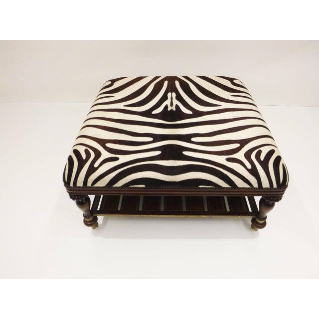 Classic design vintage zebra hide open style coffee or cocktail table. Mahogany framed, zebra hide trimmed in nailhead...