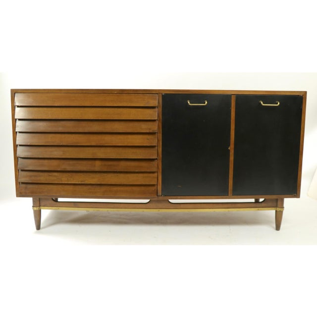 Classic Merton Gershun design for American of Martinsville dresser, sideboard, server. This stylish cabinet features three...
