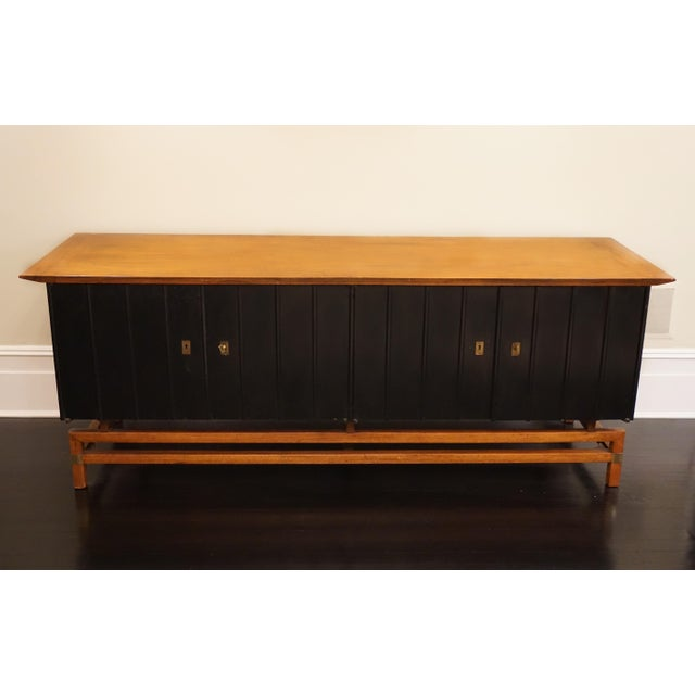 Two-toned wood, stunning and unusual credenza finished in a dark brown and golden maple wood. The interior has shelves for...