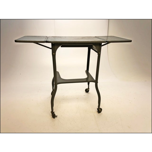 "VINTAGE TYPEWRITER TABLE. Original gunmetal gray paint. Original label reads ""Tower - Sears"". The piece dates to the..."