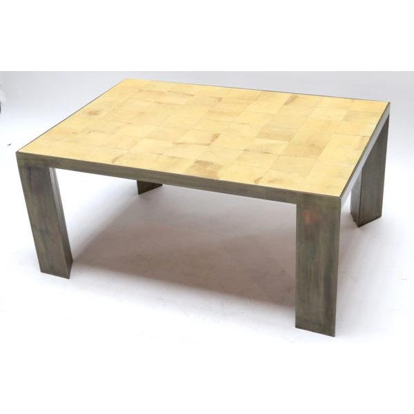 Parchment coffee table with metal legs.