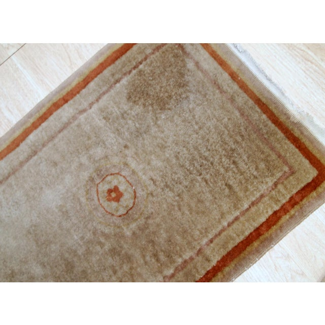 Handmade vintage rug from China made in beige wool. The rug is from the end of 20th century in original good condition....