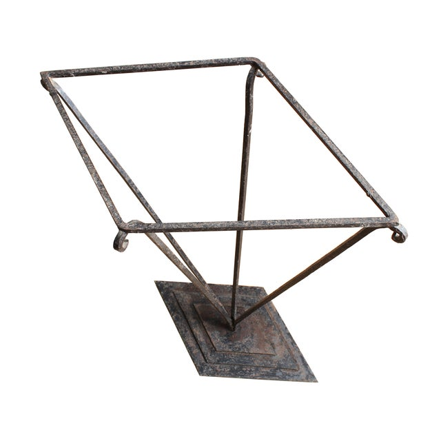 Simple angular lines take this iron umbrella stand from merely functional to a piece of hallway sculpture.